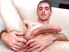 horny beefy chap with body hair masturbates his enormous cock