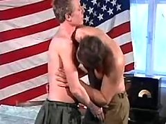 Young army soldiers enjoy oral-sex copulation