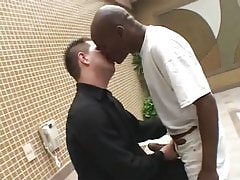 Interracial homosexuals kiss by pool