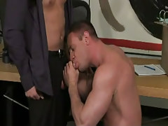 Muscle man-lover sucks hard dick in office