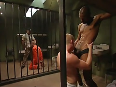Two prisoners suck huge ebony dicks