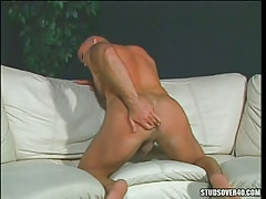 Hairy muscle gay guy stretches heavy buttocks