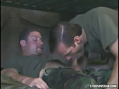 Military chap sucks his curly assistant