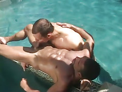 Cute gay guy sucks muscle dilf in pool