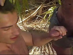 Hairy gay gets semen in tropic forest