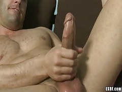 Hairy dilf masturbates on bed