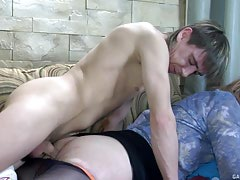 Sleeping guy getting his appliance blown and prepared for anal by a lascivious slave