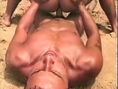 Twinks make anal love on the beach